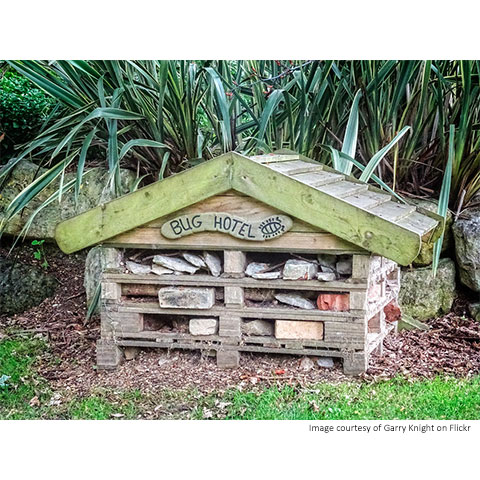 A bug hotel, layered with pallets, and an apex roof