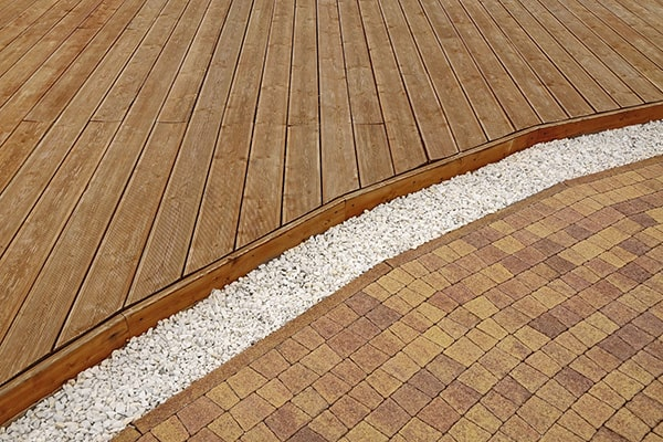 Is a Deck or Patio Better for Garden Design?