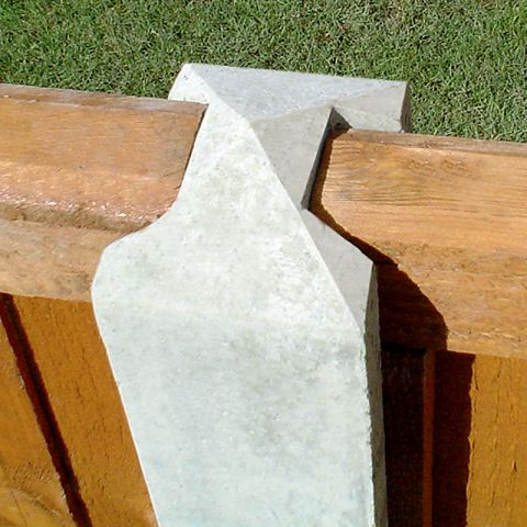 a close up view of a concrete fence post in situ