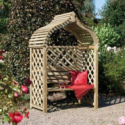 a japanese-style wooden garden arbour accessorised with red cushion and blanket