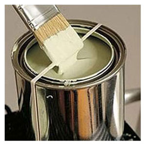 A tin of cream-coloured paint and a paint brush
