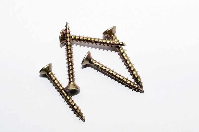 5 gold screws on a white background